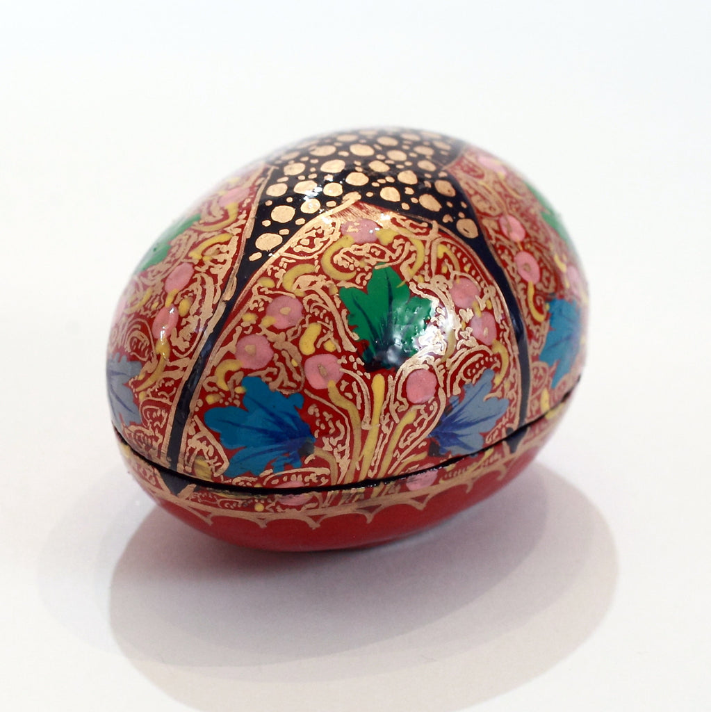 Red and black egg-shaped paper mache box