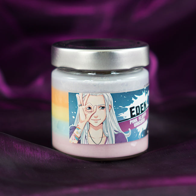 anna blue soy wax character candle with a rainbow gradient in a glas jar with a metal lid and a wood wick featuring Eden