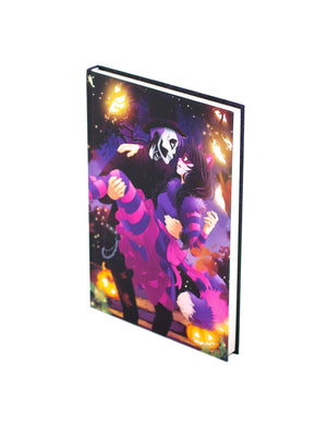 Hardcover Anna Blue notebook featuring Cheshire cat Zoe and skull boy Henry in Halloween outfits.