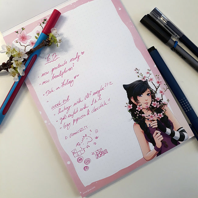 A5 (5.83 x 8.27) sized notepad with Zoe and a cherry blossom branch with 50 sheets, 1 sided print 80g/qm natural paper with subtle grid pattern, grey cardboard backing