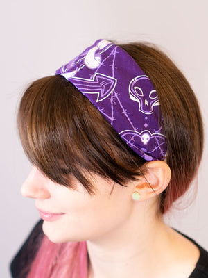 purple cotton snake heart bandana used as headband,