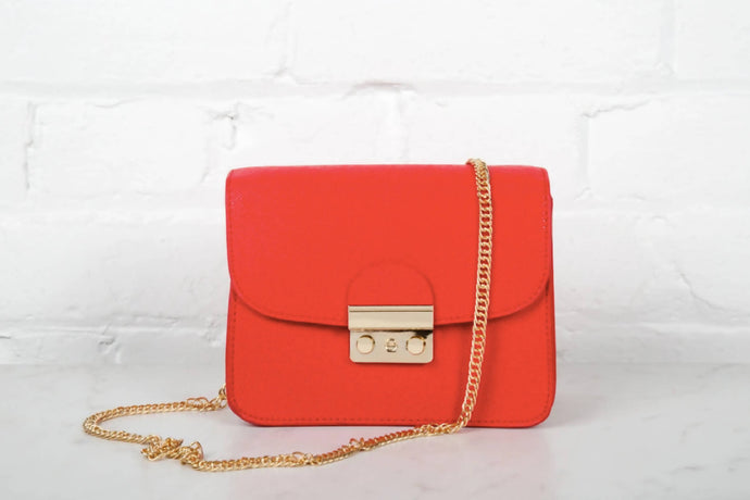 Bright Red Purse With Gold Detailing