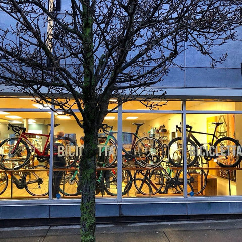 BICICLETTA West Broadway store front at dusk - selling premium road bikes, mountain bikes and gravel bikes