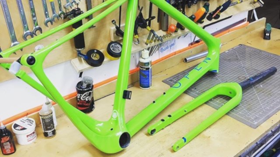 Green Open UP Frame on Work Bench - Bicicletta