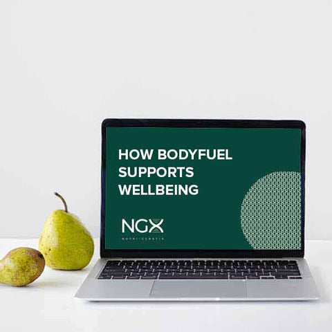 """Laptop on a desk which says """"How BodyFuel supports wellbeing""""."""