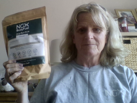 Woman holding NGX bodyfuel package
