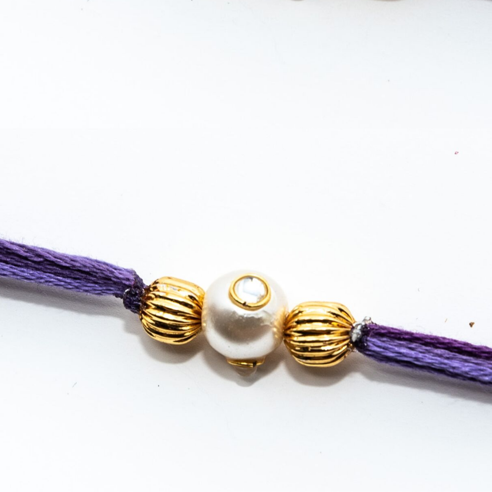 Handmade Pastel Purple Rakhi Thread With Pearl and Gold Beads