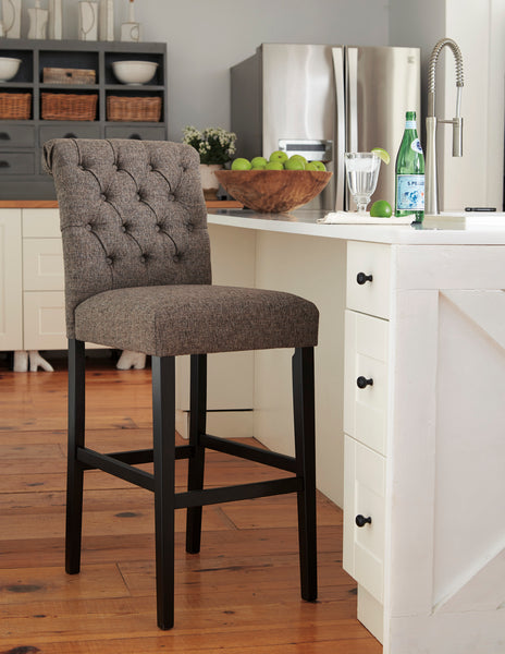 Shop Ashley Furniture Tripton Tall Upholstered Barstool at  Raley's Home Furnishing