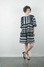 "knee length perpendicular striped dress with balloon sleeves and loose waist by jennifer glasgow on a 5'3"" model with short brown hair and short heels, facing the camera"
