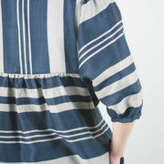 knee length perpendicular striped dress with balloon sleeves and loose waist by jennifer glasgow, close up of back gathered detail