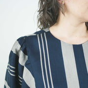 knee length perpendicular striped dress with balloon sleeves and loose waist by jennifer glasgow, close up of neck and shoulder detail