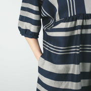 knee length perpendicular striped dress with balloon sleeves and loose waist by jennifer glasgow, close up of sleeve and gathered skirt detail