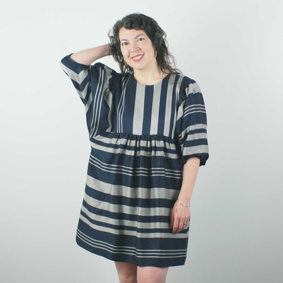 knee length perpendicular striped dress with balloon sleeves and loose waist by jennifer glasgow on a 5'6