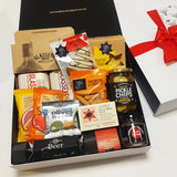X-Mas gift basket with BBQ sauces, Xmas cracker, fruit cake & pickles presented in a modern gift box.