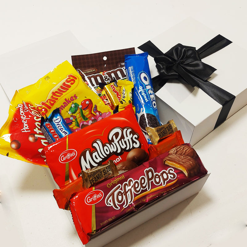 Chocolate lovers gift basket with M&M's, Maltesers, & Toffee Pops presented in a modern gift box.
