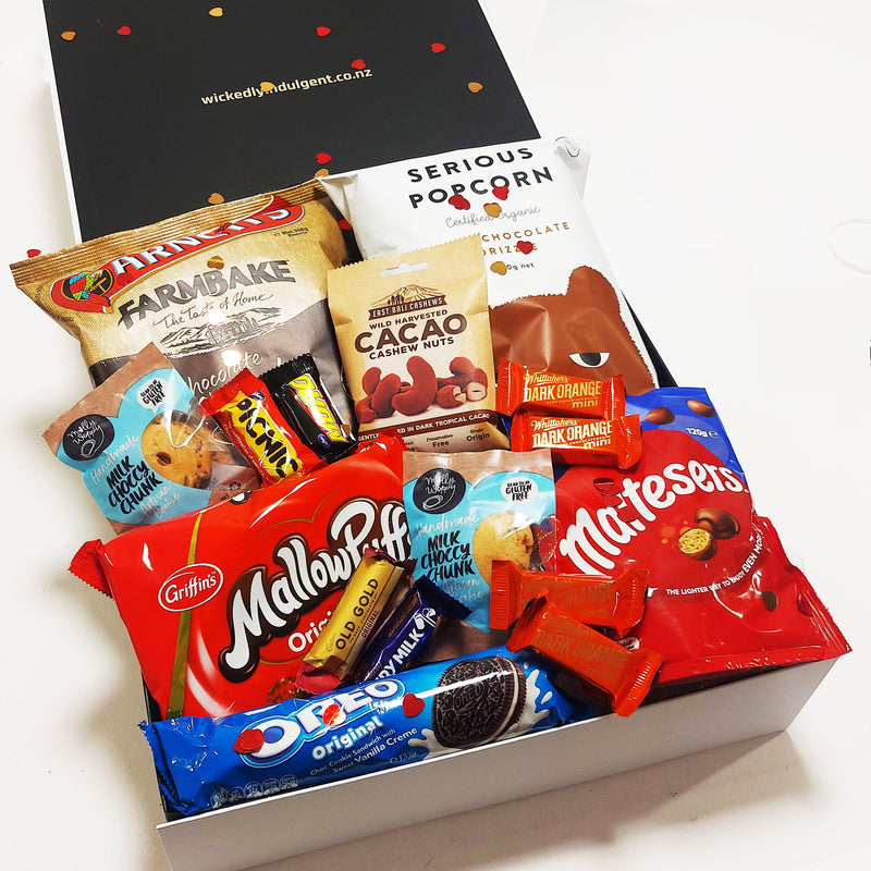 Valentines day chocolate lovers gift hamper with maltesers, mallowpuffs, cookies & Oreos, presented in a modern gift box.