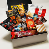 Covid Cabin Fever Gift Basket with Corona Beer, Popcorn, Toffee Pops, Chocolate & More presented in a modern gift box.