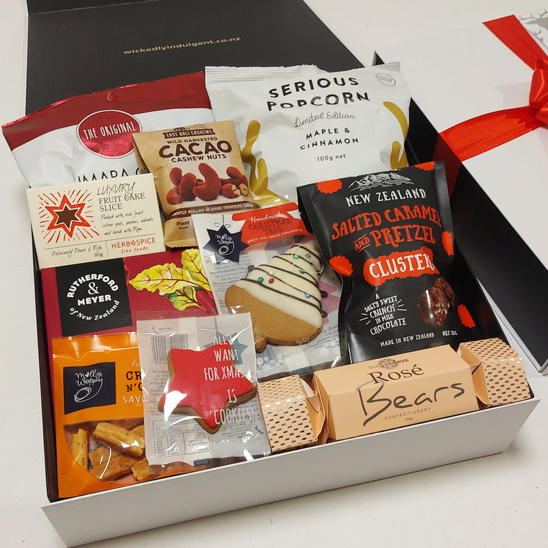 Christmas gift basket with fruit cake, dip, crackers, Xmas Cracker and more presented in a moden gift box.