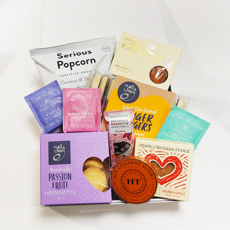 Tea gift hamper with Harney Teas, shortbread, gingerbread and more presented in a modern gift box.