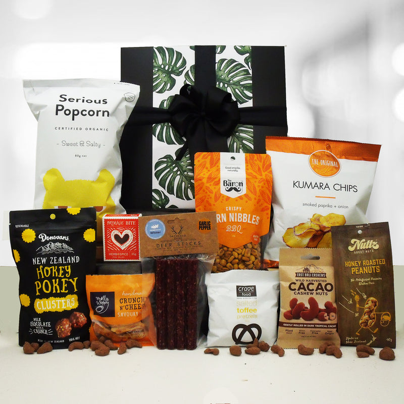 Fuel Him Up gift basket with wild venison salami, nuts chocolate, pretzels, chips and pocorn.