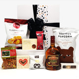Alcoholic gift basket with Appletons rum, chocolate, fudge, chips and more.