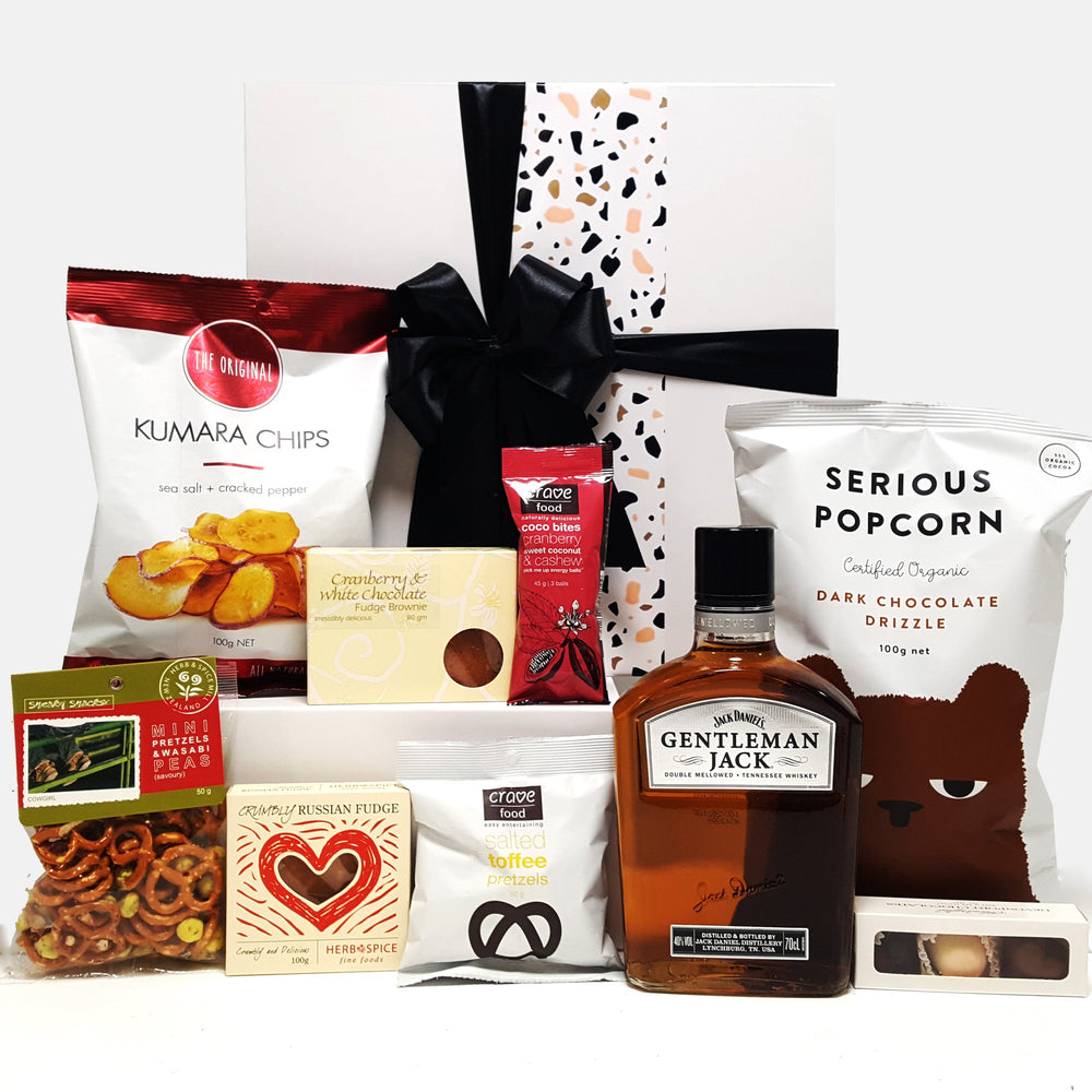 Alcoholic gift basket with Gentlemen Jack Whisky, chocolate, fudge, chips and more.