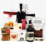 Alcoholic gift basket with Kraken Rum, chocolate, fudge, chips and more.