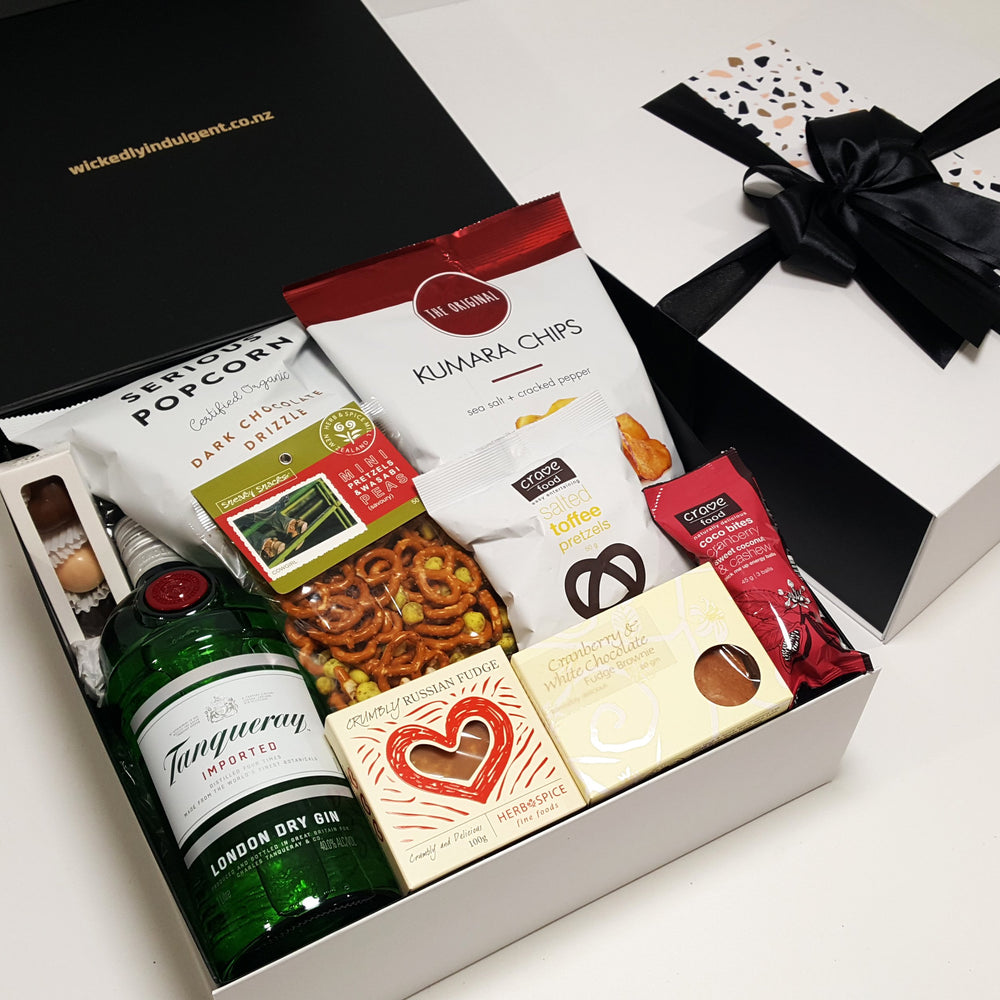 Alcoholic gift basket withTanqueray Gin, chocolate, fudge, chips and more.