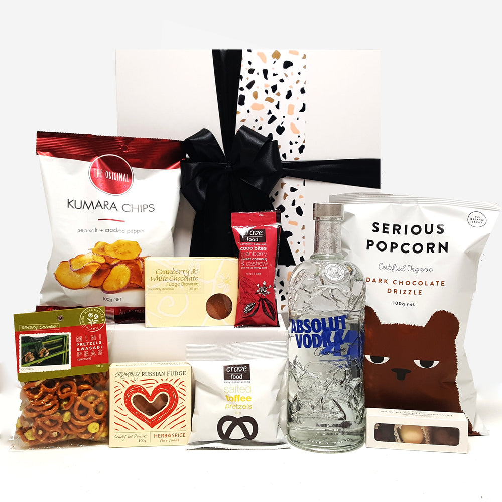 Alcoholic gift basket with Absolut Vodka, chocolate, fudge, chips and more.