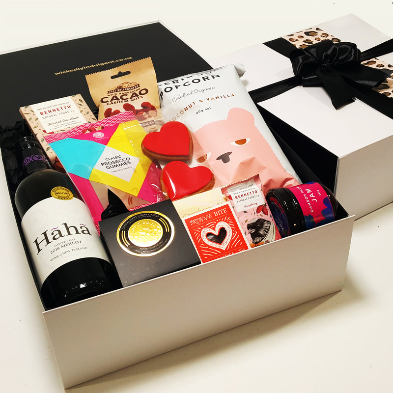 Number one Mum Mothers Day gift hamper with wine, candle, jam, and sweets, presented in a modern gift box.