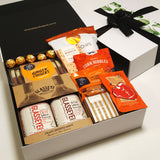 Father's Day Gift Hamper with Wild meat sauces, chocolate, ginger fingers & steam pudding.
