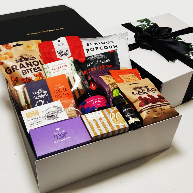 Self isoation gift basket with Hand sanitiser, pudding, jam, shortbread & more presented in a modern gift box.