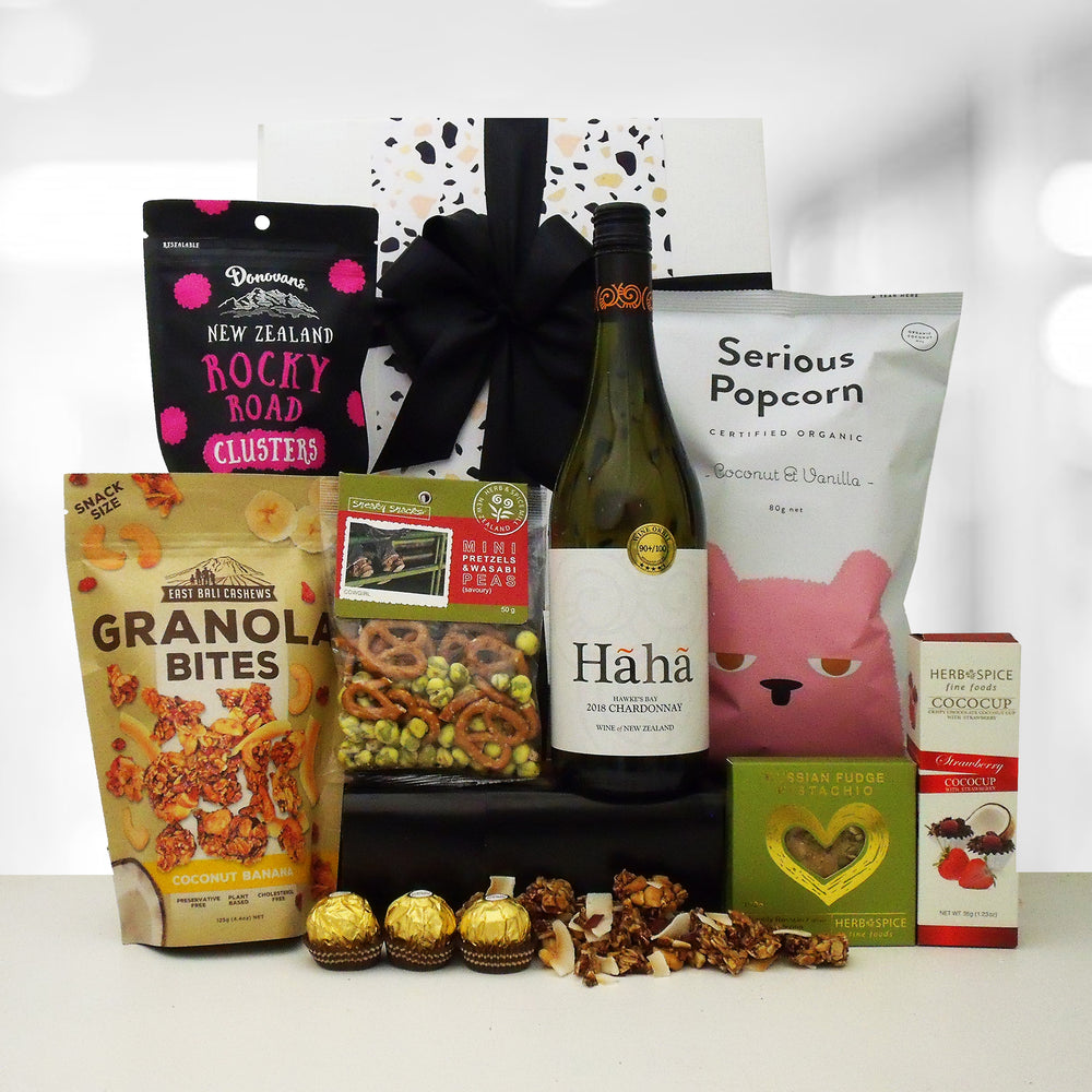 Smiles for miles  gift hamper with a bottle of wine and delicious treats presented in a modern gift box.