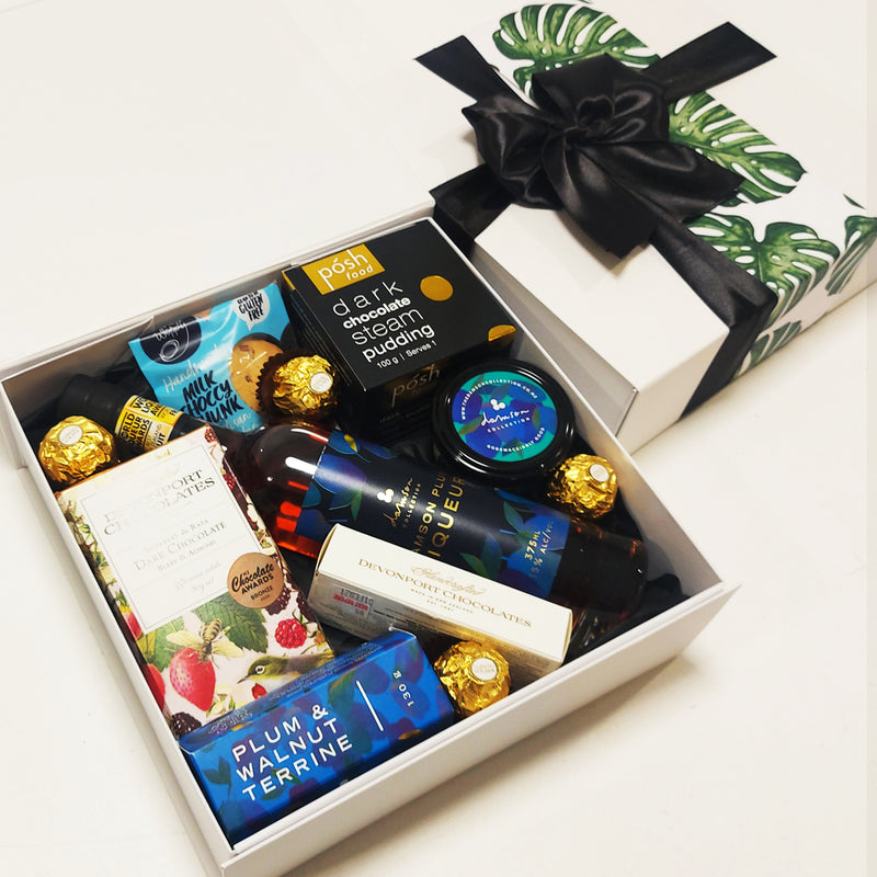 Plum Liqueuer gift basket with chocolate, terrine, plum paste and chocolate steam pudding presented in a modern gift box.