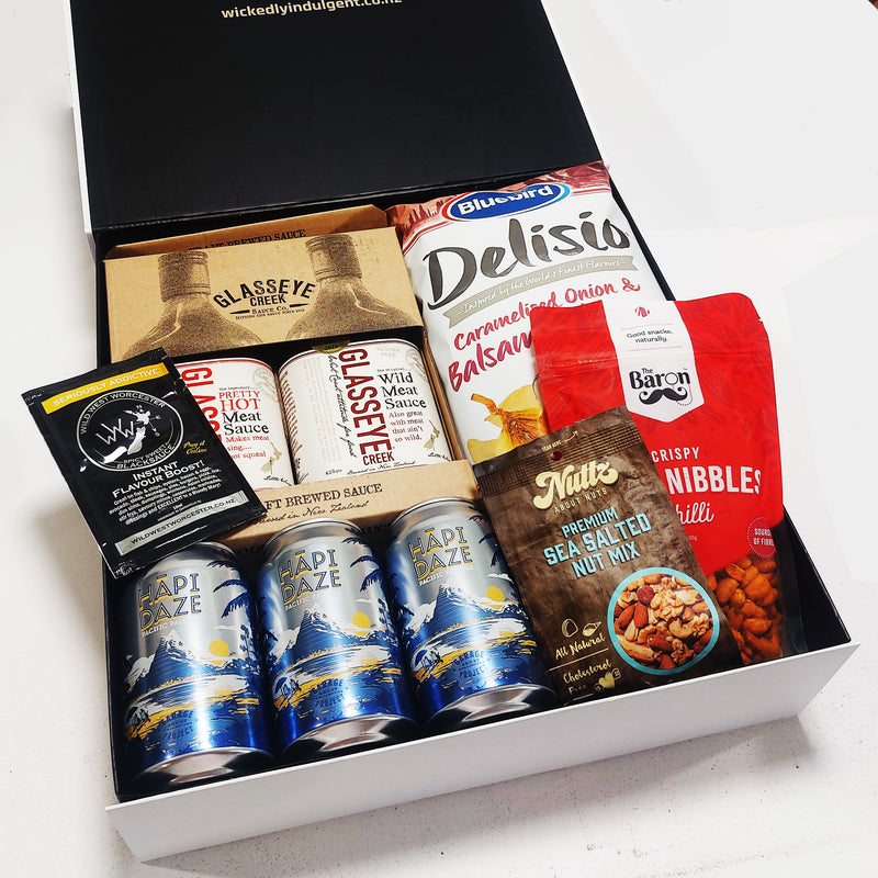 BBQ Gift hamper for him with beers or cider, BBQ sauces and nibbles, presented in a modern Gift Box.