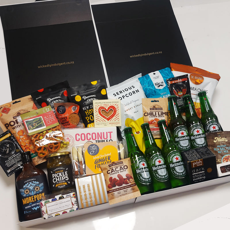 Beer Bonanza Gift hamper for the beer enthusiast filled with 6 Heinekin beers and a large assortment of chocolate, chips, pocorn and snacks best enjoyed with beer. Presented in two modern gift boxes.