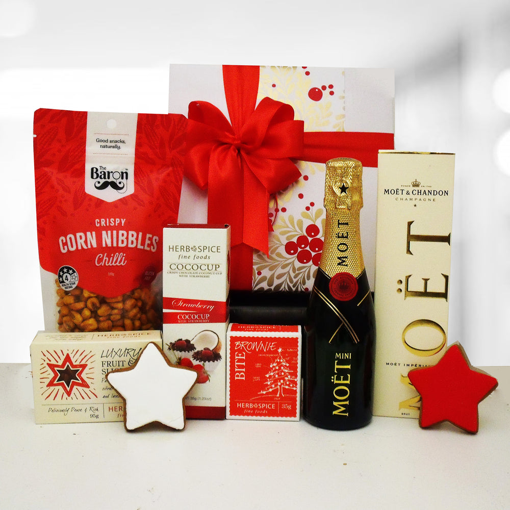 Mini Moet french champagne Christmas gift box with fruit cake, gingerbread, and other nibbles.