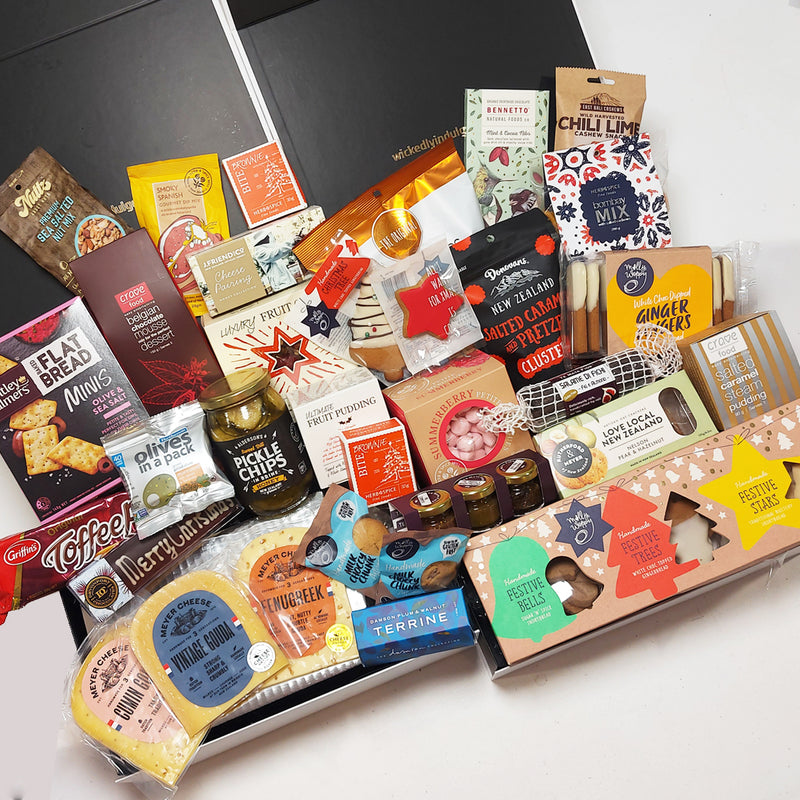Large corporate gift box with cheese, chutney, shortbread, chocolate, dessert, fruit cake and lots more all presented in a modern gift box.
