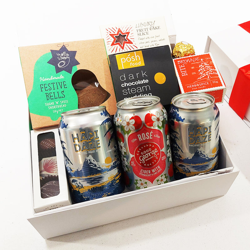 Crafty Xmas gift basketwith a cider and craft beer along with shortbread, Chocolate & fruit cake. Presented in a modern gift box.