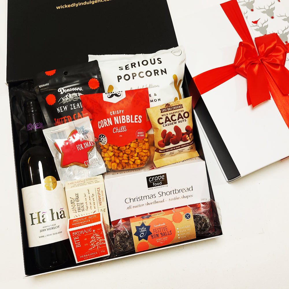 Christmas gift hamper with wine, shortbread, chocolate & fruit cake presented in a modern gift box.