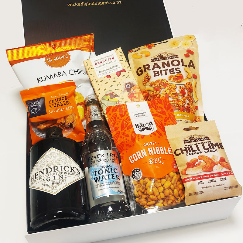 Gin for the win gift basket with Tanqueray gin, fever tree tonic, chocolate, chips and nibbles. Presented in a modern gift box.