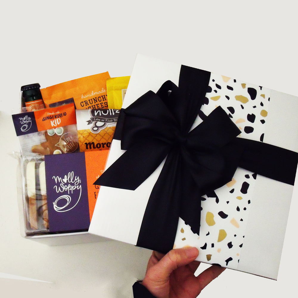 Ginger Ninja gift basket with alcoholic ginger beer, white choc ginfer fingers, gingerboy, nuts and dip all presented in a modern gift box.