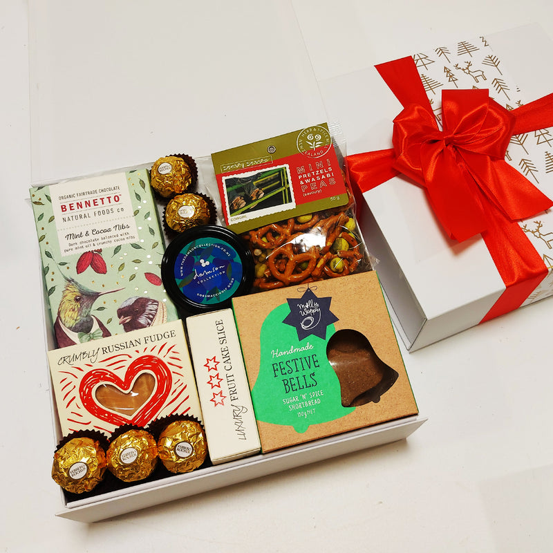 Grinches goodies Xmas Gift Basket with fruit cake, chocolate, shortbread, pretzels, russian fudge and a plum paste.
