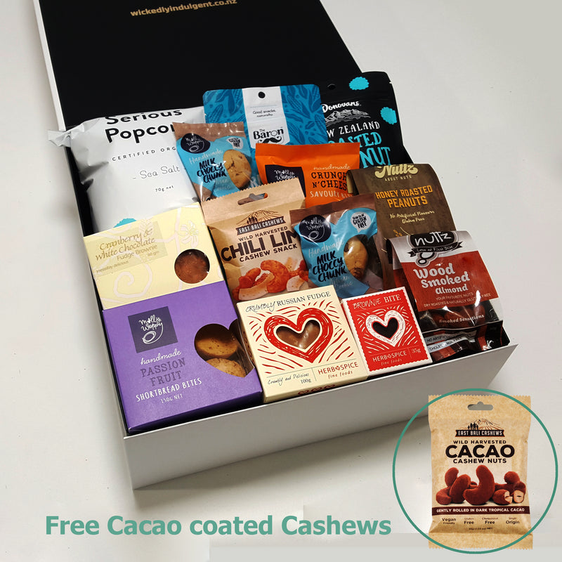 Weekly special Guilty pleasure sweet and savoury gift basket with a free pack of Cacao coated cashews presented in a modern gift box.