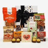 Han.gry gift basket with Nuts, Chocolate, Fudge & Pretzels presented in a modern Gift Box.