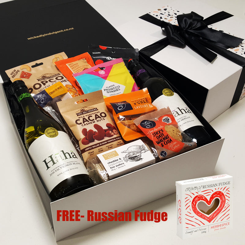 Hot Summer Nights gift hamper with two wines, popcorn, nuts, dip, chocolate & more, presented in a modern gift box.