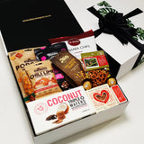 In a pickle gift basket. Sweet and savoury snacks presented in a modern gift box.