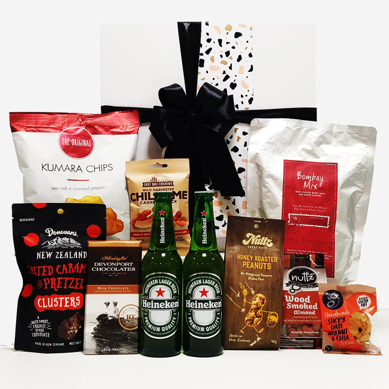 Just for him gift basket for men with Beer. Nuts, Chips, Chocolate & more presented in a modern gift box.