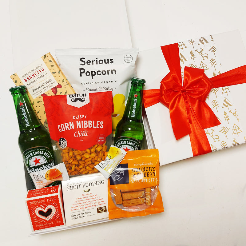 Christmas gift basket for men with beer, nibbles, fruit pudding & chocolate all presented in a modern gift box.