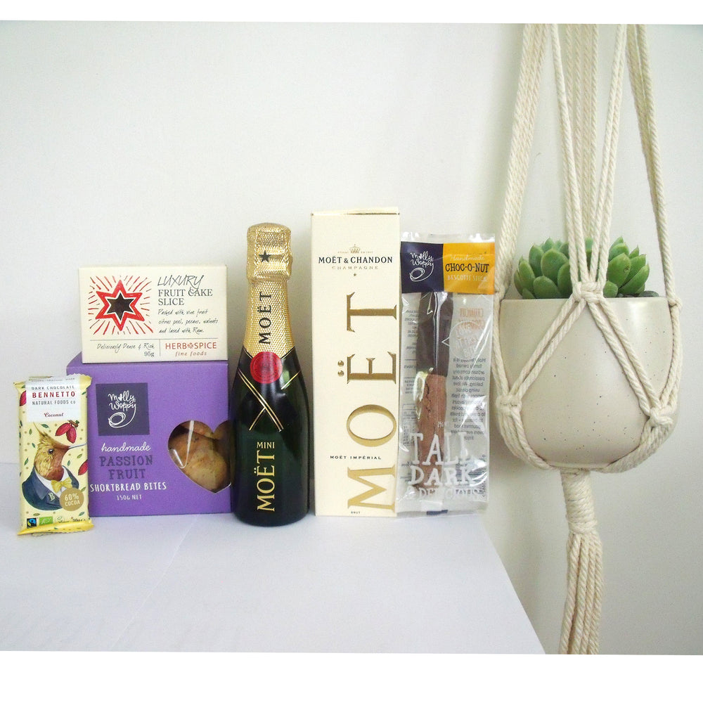 Christmas gift box with a macrame hanger, moet champagne, Xmas fruit cake,choShortbread.